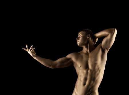 naked statue: Strong athletic man portrait posing with metal skin