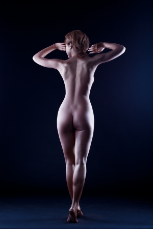 naked statue: Woman with perfect nude body like statue with metal skin make-up