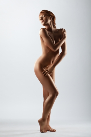 naked statue: Beauty Woman with perfect nude body like statue with metal skin