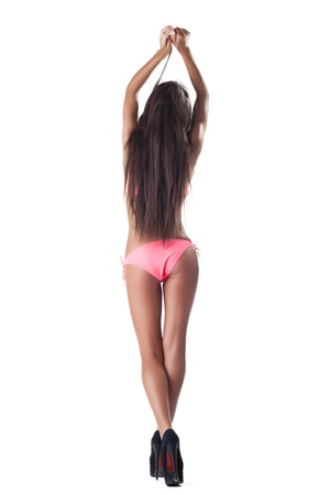 young beauty woman with long hairs in rose bikini swimsuit isolated photo