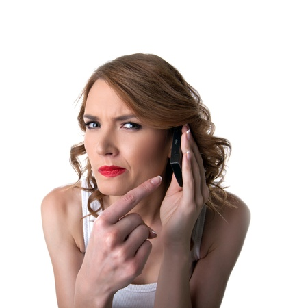 suspicious: Young woman point on cell phone with suspicious emotion isolated