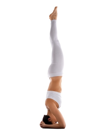 strong woman coach in white cloth stand on head yoga asana isolated Stock Photo - 15200710