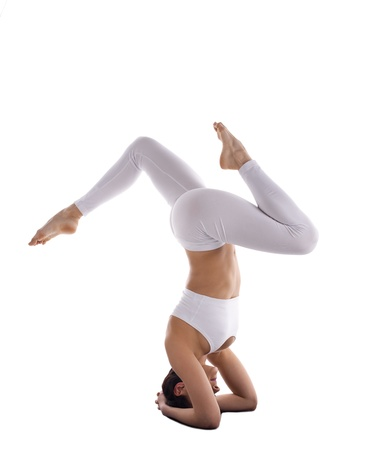 young woman trainer in white stand on head yoga asana isolated Stock Photo - 15200714