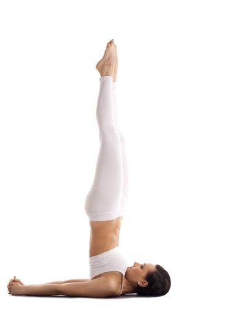 young woman trainer in white stand on neck yoga asana isolated photo