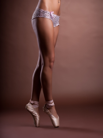 amazing girl legs in panties stand on ballet pointes photo