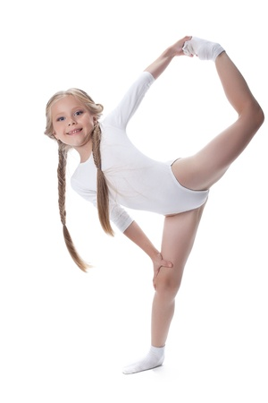 the gymnast: Full length portrait of kid gymnast  Isolated on white
