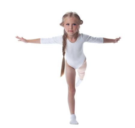 Full length portrait of kid gymnast  Isolated on white photo