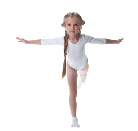 Full length portrait of kid gymnast  Isolated on white photo