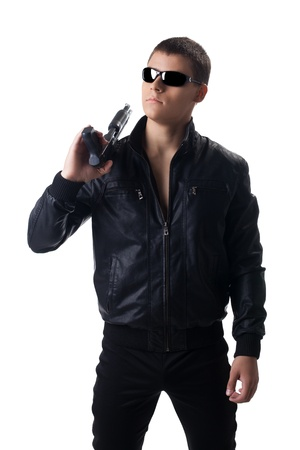 Security officer in black leather with shotgun isolated photo