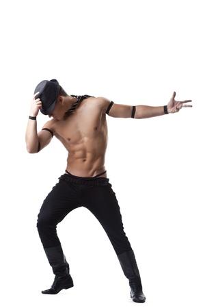 male nude: uomo forte danza striptease - tenere il cappello in mano, isolato