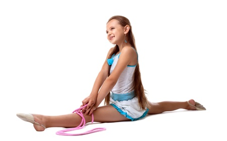 Young kid gymnast posing with skipping rope isolated photo