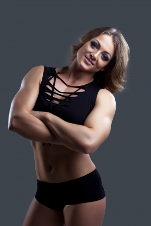 Athletic beauty woman bodybuilder in fashion cloth portrait photo
