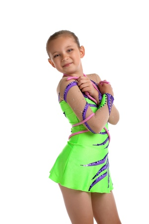 small Girl portrait posing in green costume - young gymnast isolated photo