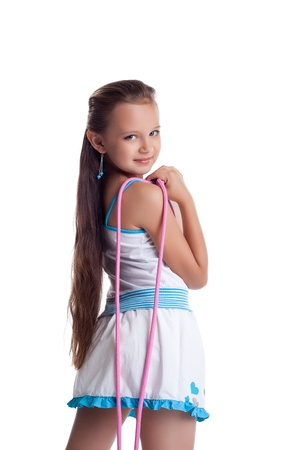 Young teen gymnast posing with skipping rope isolated photo
