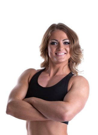flex: Young athletic woman body builder portrait isolated