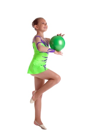 young gymnast: young gymnast teen girl dance with green ball isolated