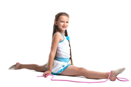 Young kid gymnast doing split with skipping rope isolated photo