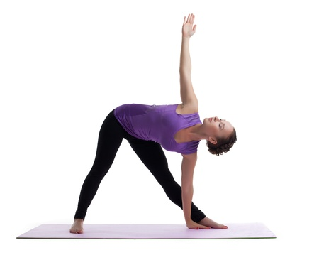 young woman posing in yoga asana on rubber mat isolated Stock Photo - 15167315