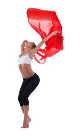 strong wind: Young blond woman dance with red flying fabric isolated