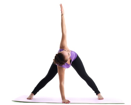 young woman yoga instructor demonstrate asana on rubber mat isolated Stock Photo - 15231201