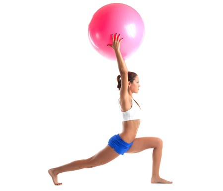 young woman stand with fitness ball isolated photo