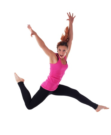 air jump: Young athletic woman doing hight jump run in air isolated