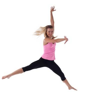 Blond woman doing jump in fitness cloth isolated photo
