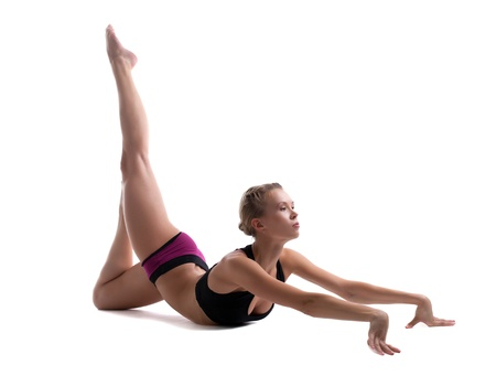 flexible: young woman in fitness costume show perfect stretch isolated