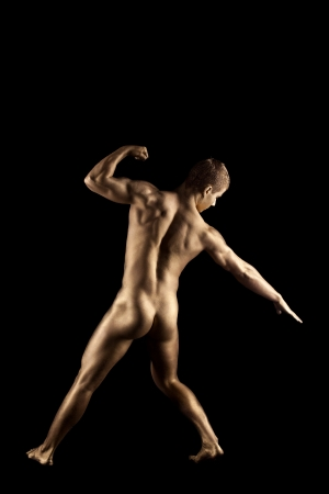 naked statue: Naked athletic man posing in metallic skin make-up Stock Photo