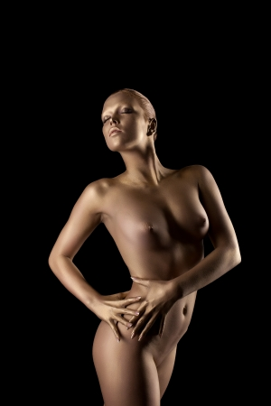 nude art model: Beauty nude woman like gold statue with metal make-up