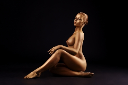 naked statue: Beauty nude woman like gold statue with metal make-up