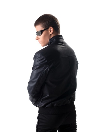 Security officer in black leather jacket and glasses isolated photo