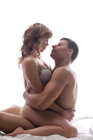 Couple lovers sit in bed - sexual games isolated