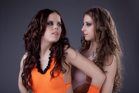 two girls - young sexy go-go dancers kiss together photo
