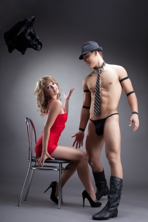 woman sex: young sexy girl in red undress striptease man Stock Photo