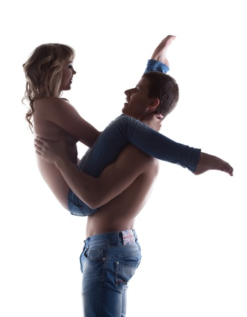 Sexy couple posing topless in jeans silhouette isolated Archivio Fotografico