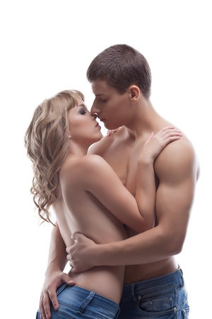 young strong man and sexy girl kiss topless in jeans isolated Stock Photo - 15720603