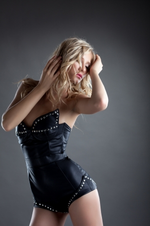 Beautiful blond woman in sexy leather corset photo