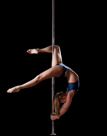 nude gymnast: athletic beauty woman show high gymnastic level during pole dance Stock Photo