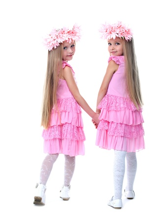Long hair: Full length portrait of little girls in pink dresses  Isolated on white