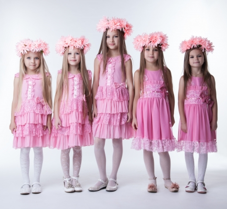 little girl dress: Full length portrait of five little girls in pink dresses and wreaths Stock Photo