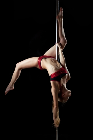 Full length portrait of sexy pole dance woman in red bikini photo