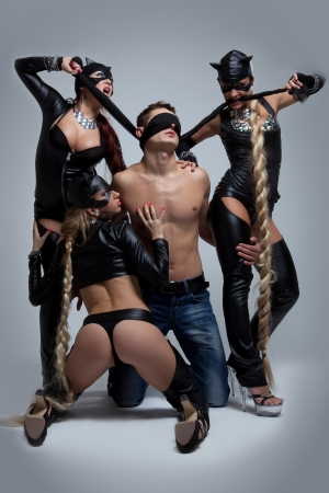 Full length portrait of women and man playing sexual game photo