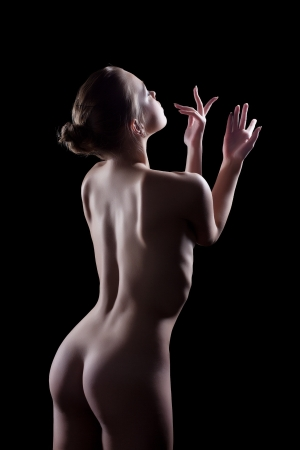 nude woman back: Studio portrait of nude young woman