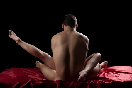 Studio portrait of young couple having sex in bed Stock Photo - 16588696