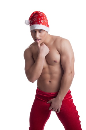 Sexy athletic man in erotic christmas costume show desire isolated