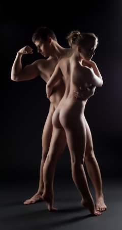 Full length portrait of nude man and woman in dark Stock Photo - 16727238