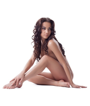 brunette naked: Nude beautiful young woman sitting on floor  Isolated on white