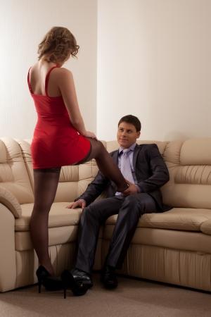 Full length portrait of couple flirting in living room Stock Photo - 16825965