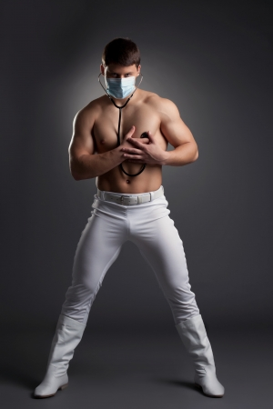 Sexy dancer in white doctor costume  Studio portrait photo